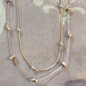 2 sterling silver beaded necklaces.